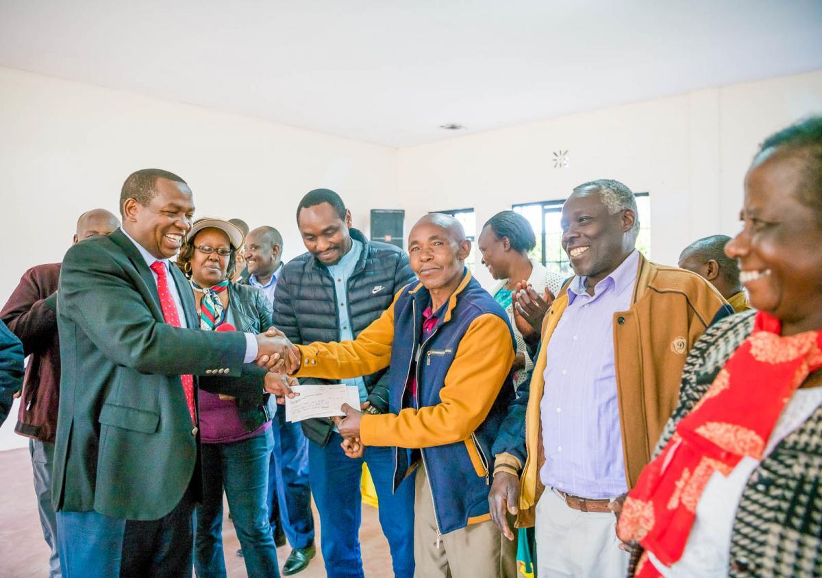 Governor presenting cheques worth KES 44.8 Million to farmer representatives of 110 groups in Tigithi, Ngobit, Segera, Rumuruti, Ol Moran and Salama w
