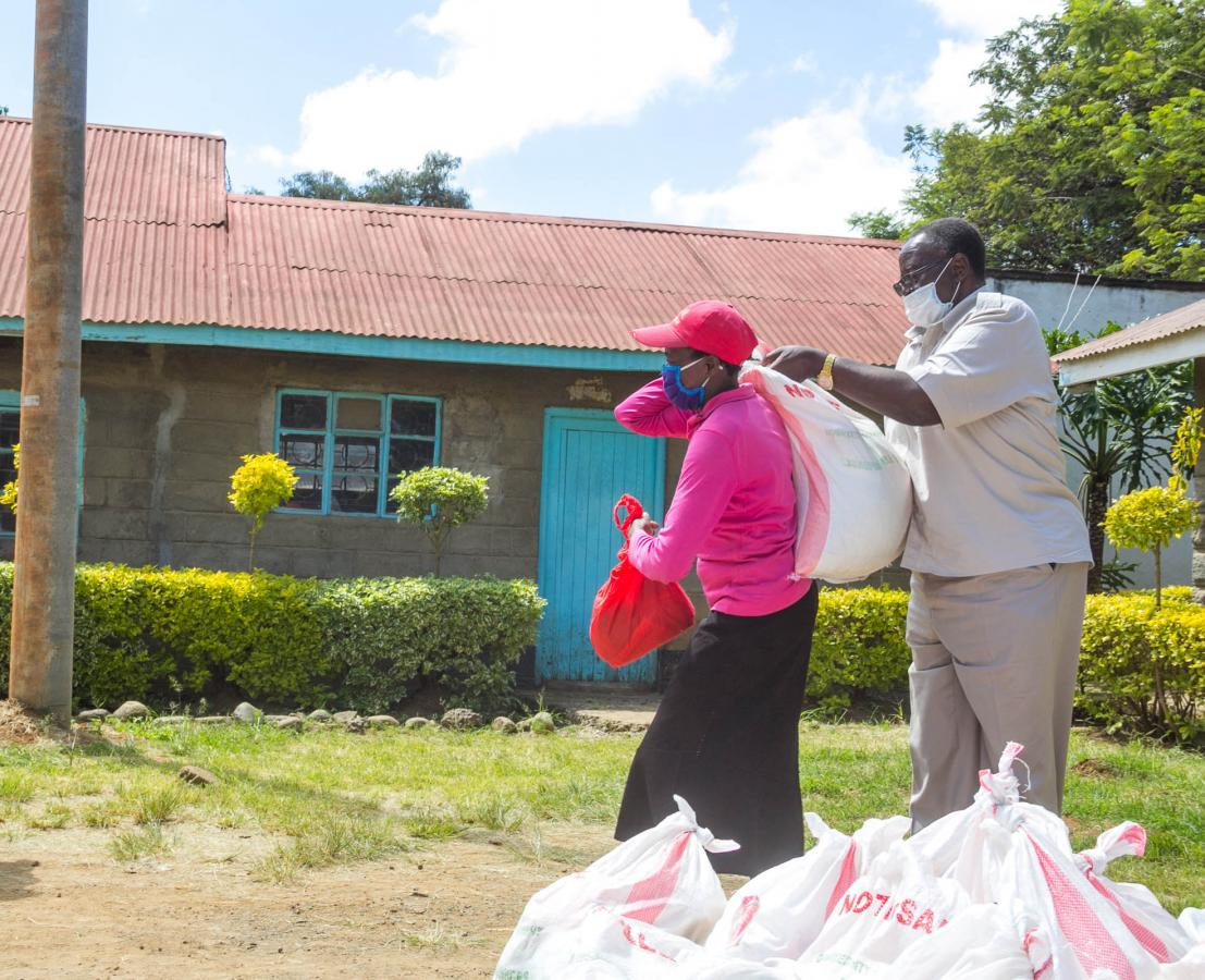 Strategic Food Reserve Chairman Dr. Noah Wekesa shares a Lisha Jamii Initiative Care Package.